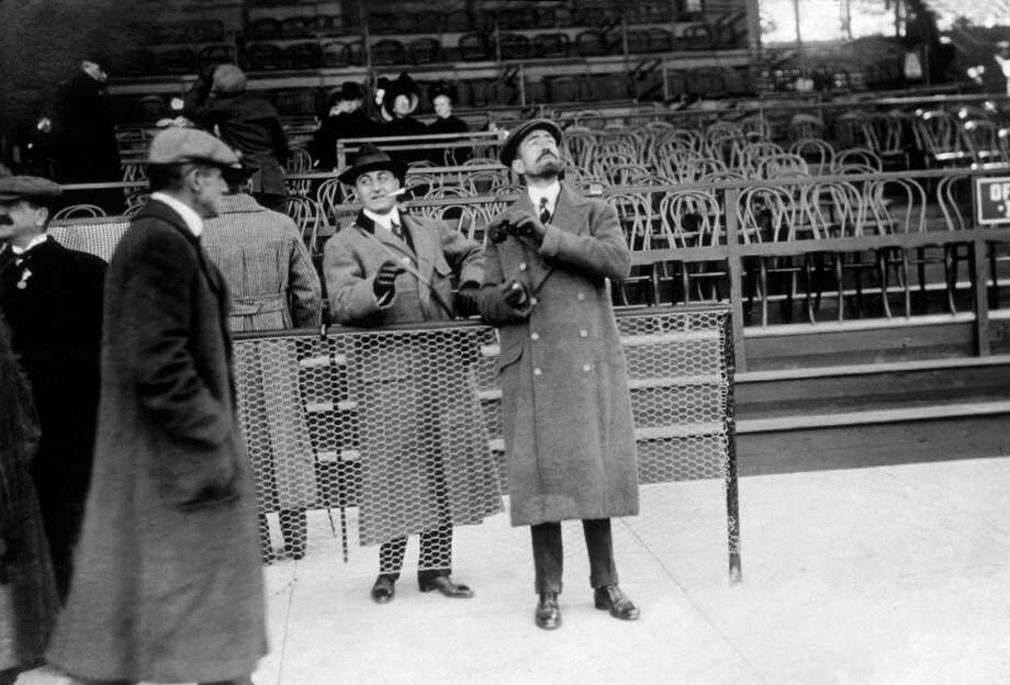 American financier and philanthropist Cornelius Vanderbilt II (right) watches an air show, in New York, circa 1910. Photo: Edwin Levick, Getty Images / Archive Photos