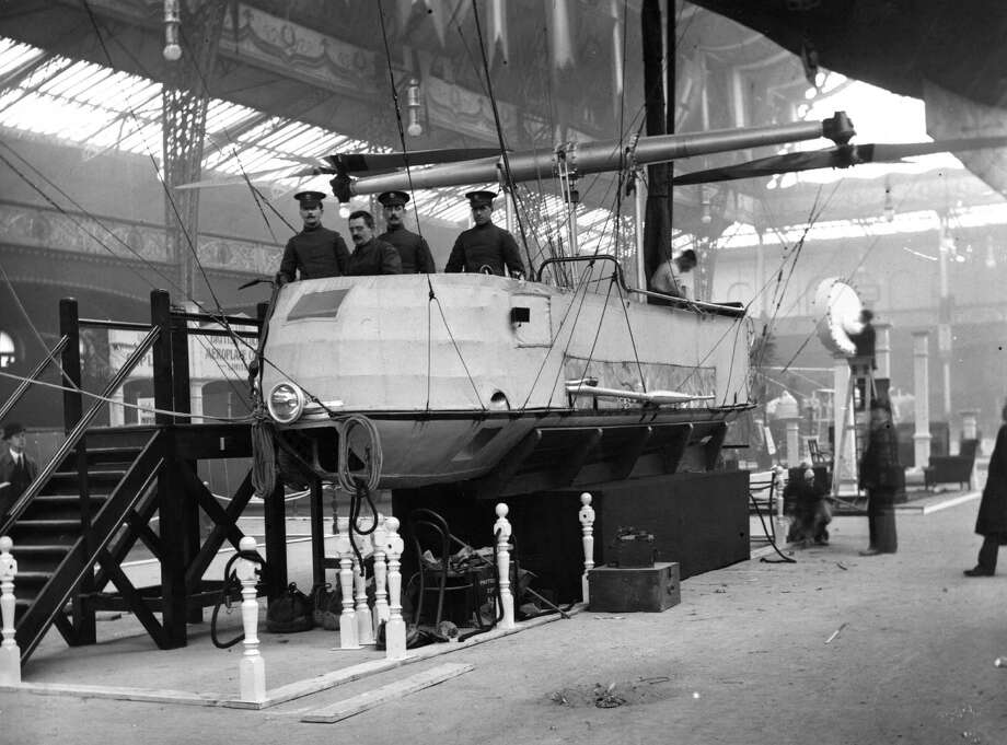 Men of the British Army Flying Corps  works in the car of the 'Delta' at the Olympia Air Show in London on February 13, 1915. Photo: Hulton Archive, Getty Images / Hulton Archive