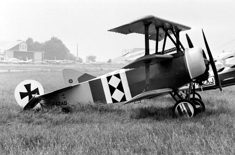 "The German fighter triplane Fokker Dr 1 of the baron Manfred von Richthofen (1892-1918), the ""Red Baron,"" is shown during an air show, circa 1917. Photo: J. Cuinieres, Roger Viollet/Getty Images / J. Cuinieres/Roger Viollet"