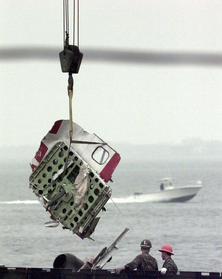 In this Aug. 3, 1996, file photo, a door from the wreckage of TWA Flight 800 is unloaded at the Shinnecock Coast Guard Station in Hampton Bays, N.Y. Photo: BEBETO MATTHEWS, AP Photo/Bebeto Matthews / Associated Press