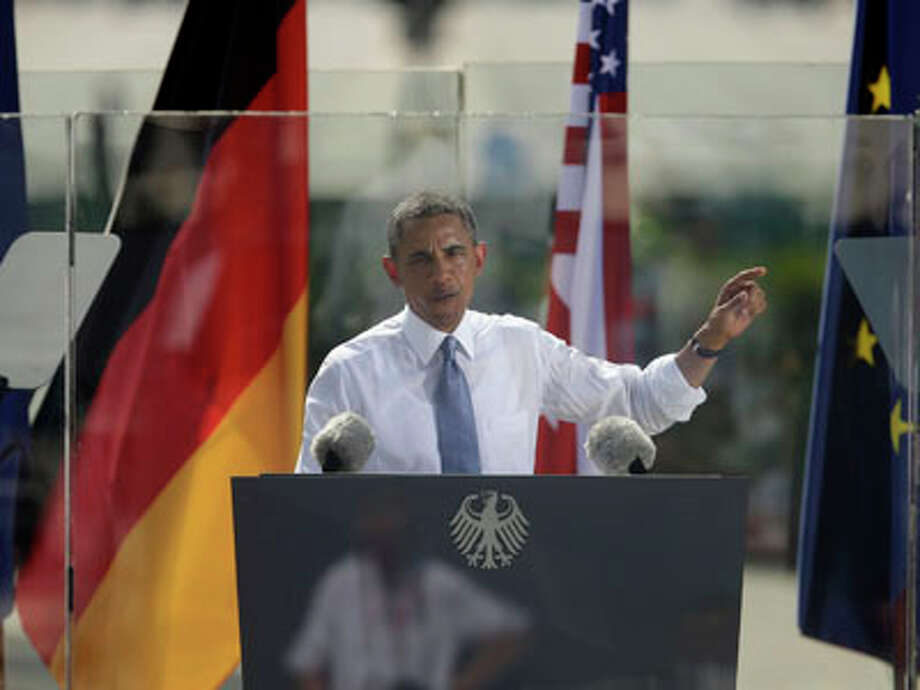 "President Barack Obama speaks in front of the iconic Brandenburg Gate in Berlin Germany, Wednesday, June 19, 2013. Obama spoke on the Gate's eastern side, across the old border from where President Ronald Reagan gave his unforgettable ""Mr. Gorbachev, tear down this Wall!"" speech in June 1997. This week also marks the 50th anniversary that President John F. Kennedy confronted Cold War tension in Wall-divided Berlin by telling residents, ""Ich bein ein Berliner."" Photo: Pablo Martinez Monsivais, AP / AP"