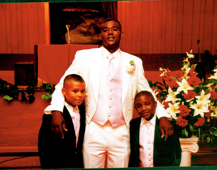 Cedric Howard, 34, poses for a photo on his wedding day with his two young sons. Howard was fatally shot by police on Monday, June 17, 2013, following an altercation with another man in the 5200 block of Gawain.