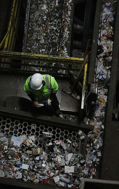 Paper, cans and plastics are sorted at the Recycle Center at Pier 96 in S.F. in January. Photo: Liz Hafalia, The Chronicle