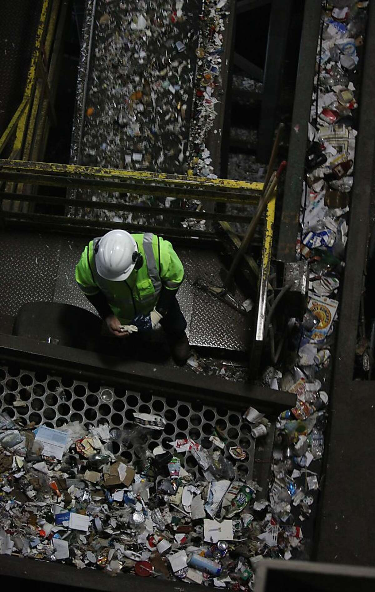 Recology staff sorting paper, cans, and plastics at the Recycle Center @ Pier 96 in San Francisco, California, on Wednesday, January 2, 2013.