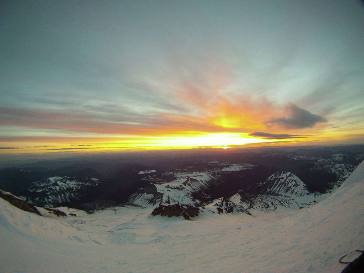 A look east, from Mount Rainier, as the sunrises on June 21, 2012, the summer solstice. This would be the beginning of the longest day of the year, and for four Texas mountain climbers who met with tragedy, it was the longest day in so many ways.(By Ross Van Dyke)