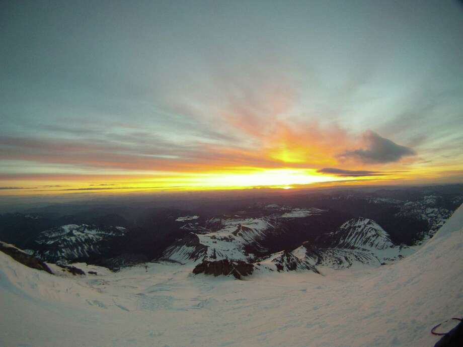 A look east, from Mount Rainier, as the sunrises on June 21, 2012, the summer solstice. This would be the beginning of the longest day of the year, and for four Texas mountain climbers who met with tragedy, it was the longest day in so many ways.(By Ross Van Dyke) Photo: Ross VanDyke / handout