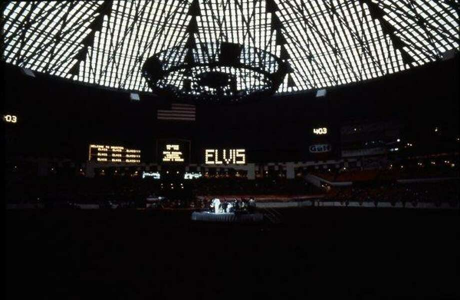 Elvis Presley performs at the 1970 Houston Livestock Show and Rodeo in the Astrodome.