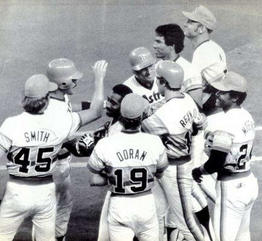 Houston Astro Craig Reynolds is congratulated by his teammates after he drove in the winning run with a single in the 10th inning of a game in 1983.