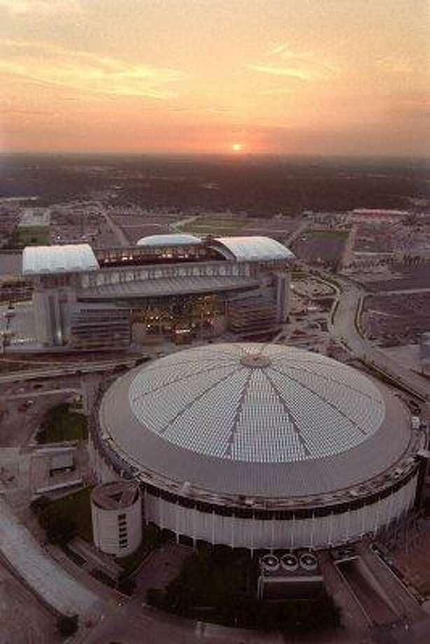 In this Aug. 2, 2002 file photo, an aerial view of Reliant Stadium, the new home of the Houston Texans and the Astrodome, former home of the Houston Oilers is shown in Houston.
