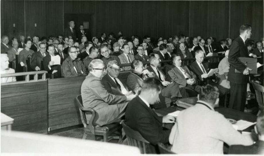 Crowd meets about the proposed county sports stadium (Astrodome) at Harris County Commissioners Court in 1961.