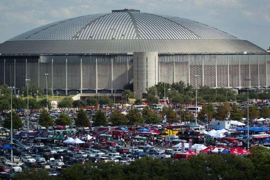 The Astrodome is seen behind the blue parking lot  full of tailgaters before an NFL football game between Houston Texans and the New York Giants at Reliant Stadium, Saturday, Oct. 9, 2010, in Houston.