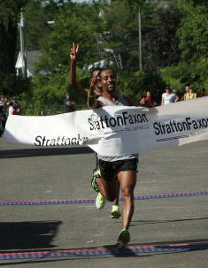 Ethiopian Tesfaye Girma, pictured crossing the finish line first at the 2012 Stratton Faxon Fairfield Half Marathon, is entered and among the favorites to claim this year's race. Photo: Contributed Photo