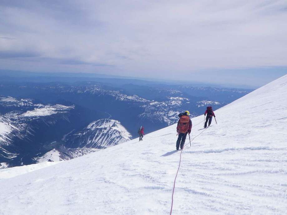 The Texans on the way down Mount Rainier, 30 minutes before their fall. (Photo by Stacy Wren) June 21, 2012 Photo: Stacy Wren / handout