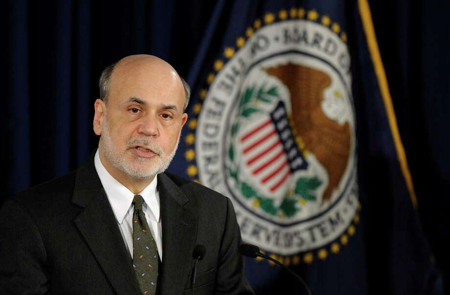 Federal Reserve Chairman Ben Bernanke speaks during a news conference in Washington, Wednesday, June 19, 2013. Bernanke. The Federal Reserve said Wednesday that it will maintain the pace of its bond-buying program to keep long-term interest rates at record lows. But it offered a more optimistic outlook for the U.S. economy and job market. (AP Photo/Susan Walsh) Photo: Susan Walsh