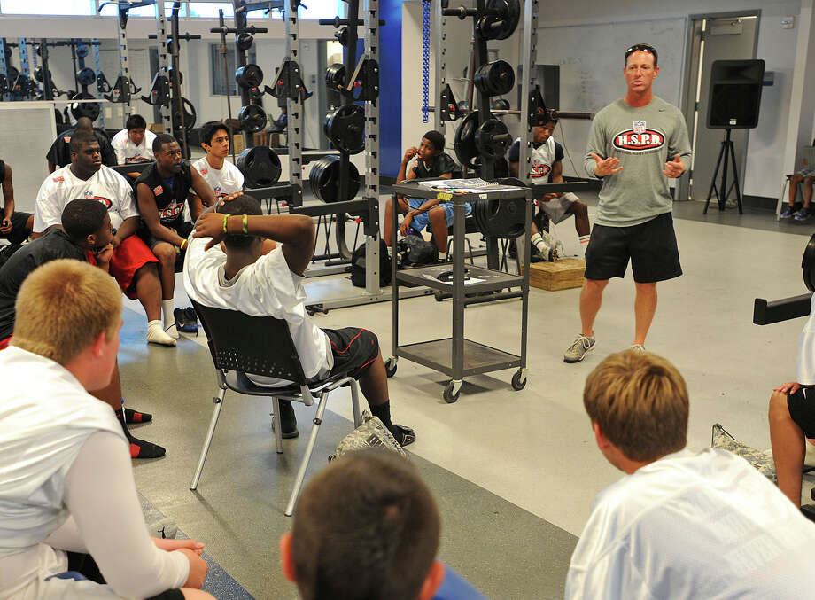 West Brook's Kevin Flanigan talks to players during an NFL development camp at the Bruin's field house on Tuesday. Photo taken Tuesday, June 18, 2013 Guiseppe Barranco/The Enterprise Photo: Guiseppe Barranco, STAFF PHOTOGRAPHER / The Beaumont Enterprise