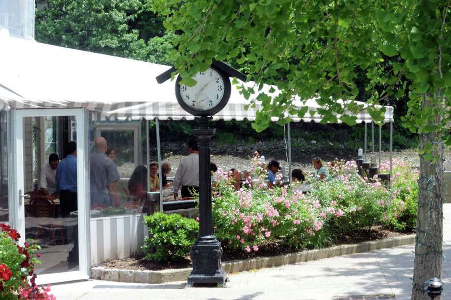 Rive Bistro's has outside dinning, at the restaurant in Westport, Conn., Wednesday, June 19, 2013. Photo: Helen Neafsey / Greenwich Time