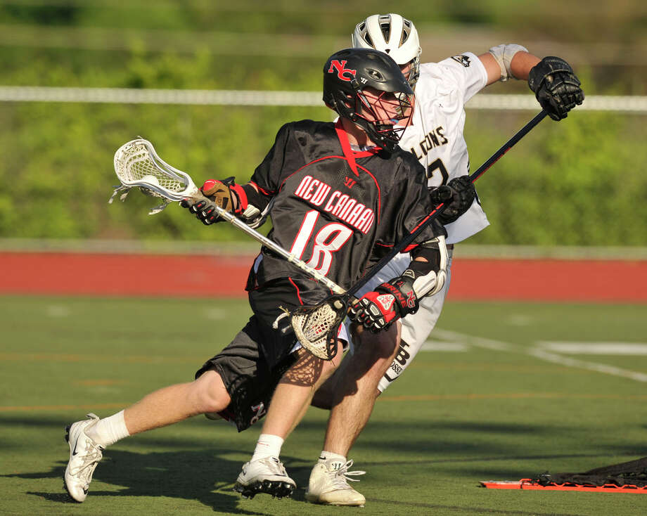 New Canaan's Peter Richardson is pressured by Joel Barlow's Alex Gallaer during their Class M semifinal game at Brien McMahon High School in Norwalk on Wednesday, June 5, 2013. Joel Barlow won 5-4 in overtime. Photo: Jason Rearick / Stamford Advocate