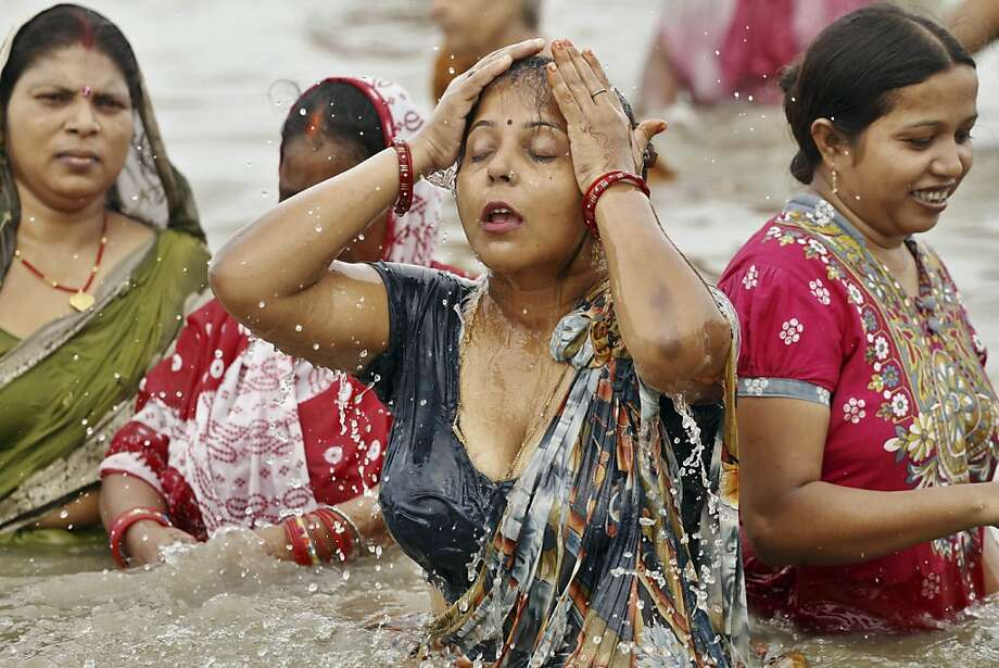 River rite: Hindu women devotees take a holy dip at Sangam, the confluence of the rivers Ganges, Yamuna the mythical Saraswati in Allahabad, India. Hindus across the country are celebrating Ganga Dussehra, devoted to the worship of the Ganges. Photo: Rajesh Kumar Singh, Associated Press