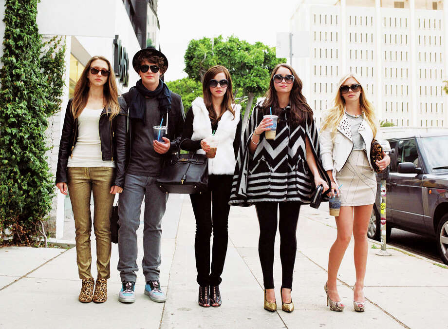 "From left: Taissa Farmiga, Israel Broussard, Emma Watson, Katie Chang and Claire Julien walk down Robertson Boulevard in Los Angeles in a scene from ""The Bling Ring."" Photo: Merrick Morton"
