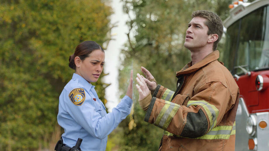 Deputy Linda (Natalie Martinez, left) and her fiance, Rusty (Josh Carter), find themselves separated by a massive transparent dome that has suddenly fallen on the town of Chester's Mill in CBS' new drama, 'Under the Dome.' Photo: CBS, Handout / ONLINE_YES