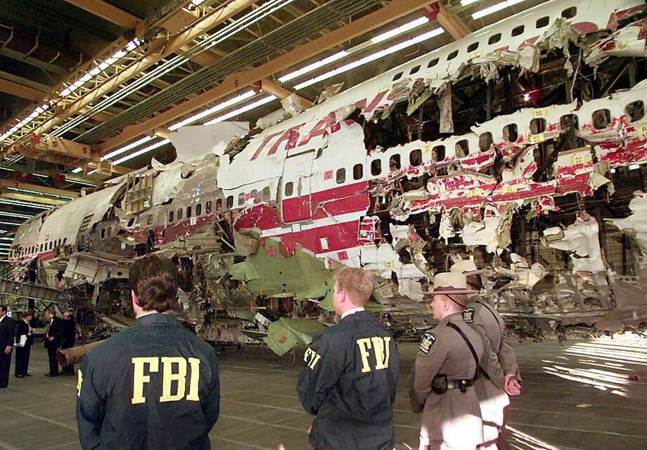 FBI agents and New York state police guard the reconstruction of TWA Flight 800 in Calverton, N.Y. Investigators say new evidence indicates that a missile may have downed the jetliner. Photo: Mark Lennihan, Associated Press