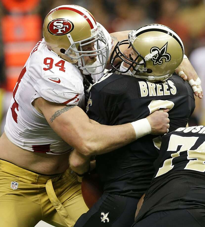 Justin Smith hopes to keep sacking guys like Drew Brees after signing an extension. Photo: Matthew Hinton, Special To The Chronicle