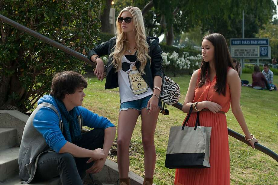 "Israel Broussard, Claire Vivien and Katie Chang plot their strategy to steal from the rich and famous in Sofia Coppola's ""The Bling Ring."" Photo: Merrick Morton, A24 Films"