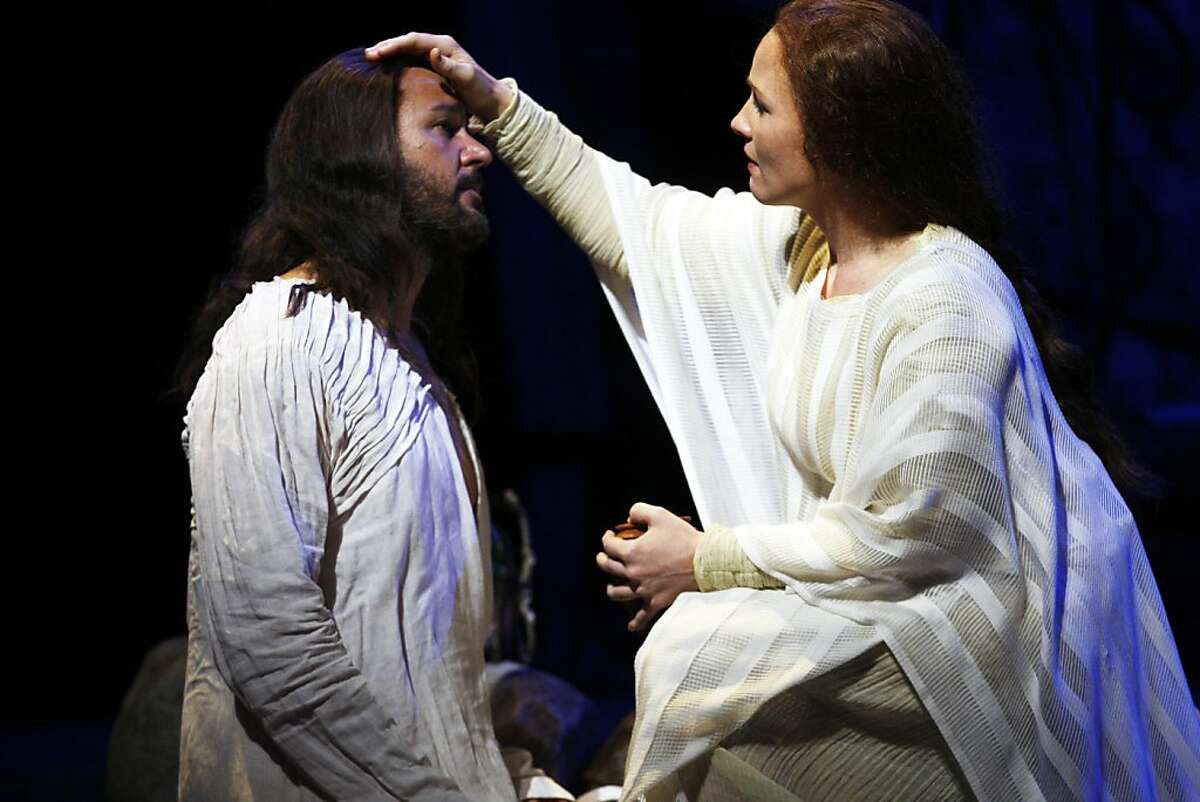 Sasha Cooke as Mary Magdalene soothes Nathan Gunn as Yeshua (Jesus) in the world premiere of Mark Adamo's The Gospel of Mary Magdalene on Sunday, June 16, 2013 in San Francisco, Calif.
