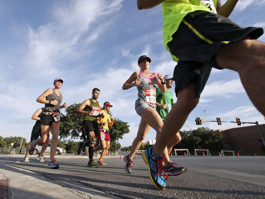 Participants take part in the Rock 'n' Roll San Antonio Marathon last year. Various runs will be held prior to the marathon to prepare runners. A five-race prep series debuts Sunday. Photo: Express-News File Photo