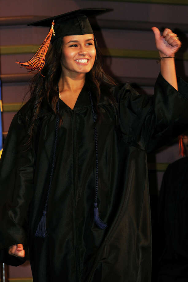 Information Systems graduate Priscilla Soares gives a thumbs up during commencement for the Bullard-Havens Technical High School Class of 2013, held at the Klein Memorial Auditorium, in Bridgeport, Conn. June 19th, 2013. Photo: Ned Gerard / Connecticut Post