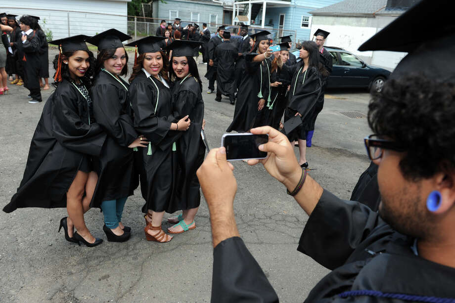 Information Systems student Clayton Coelho snaps a photo of some of his fellow graduates prior to commencement for the Bullard-Havens Technical High School Class of 2013, held at the Klein Memorial Auditorium, in Bridgeport, Conn. June 19th, 2013. Photo: Ned Gerard / Connecticut Post