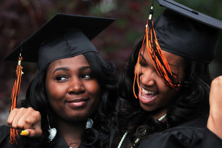 Hairdressing students Sabrina Jetter and Olivia Hines prepare to enter commencement for the Bullard-Havens Technical High School Class of 2013, held at the Klein Memorial Auditorium, in Bridgeport, Conn. June 19th, 2013. Photo: Ned Gerard / Connecticut Post