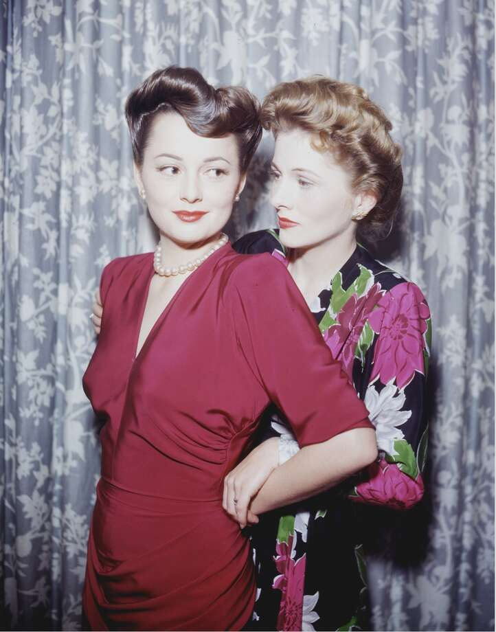 Actress Olivia de Havilland (left) with her sister, actress Joan Fontaine, circa 1945.