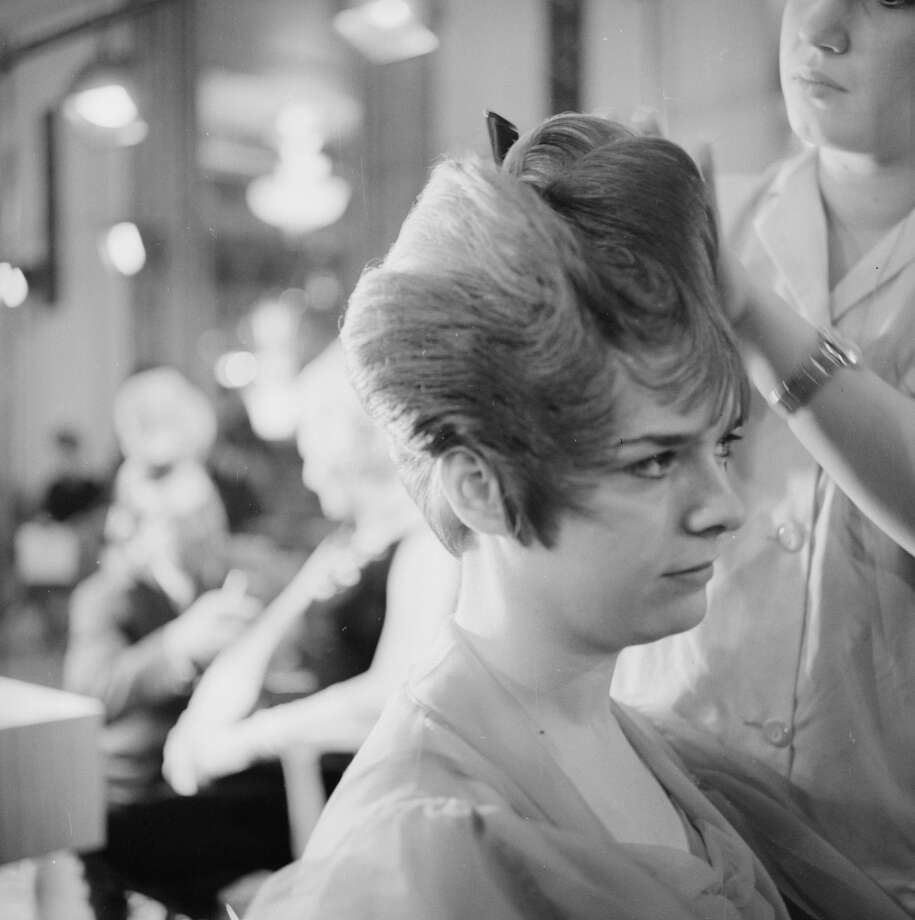 Hairdresser Maria Pellegrino creates an unusual style for Valerie Lane during a hairdressing competition in 1963.