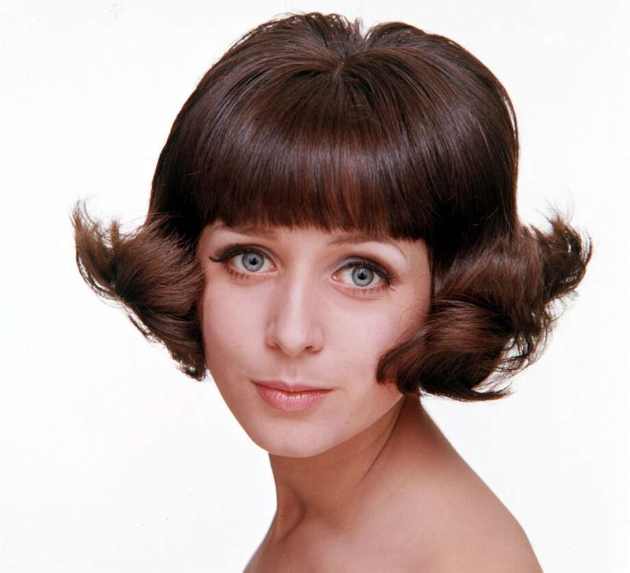 1965, A model is pictured displaying a fashionable hairstyle