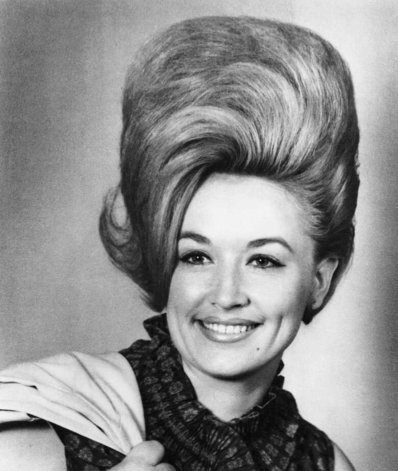 Country singer Dolly Parton poses for a portrait in 1965 in Nashville, Tennessee.