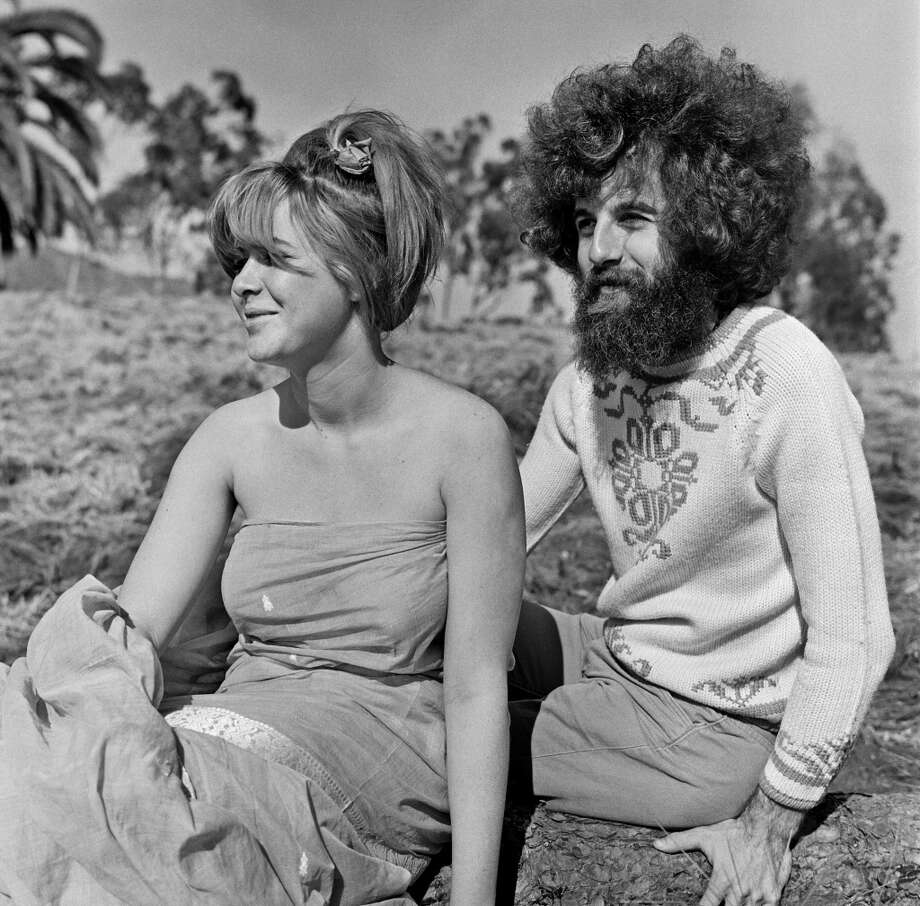 "Hippies, or ""freaks"" as they prefer to be called, relax under the sun in an open field in Los Angeles, California, in summer, 1967."