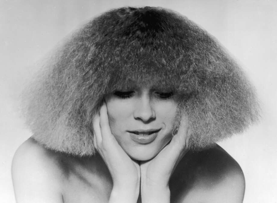 1974:  The 'Electric Cut', invented by Paris hair stylist Patrick Ales. The hair is given body by ultra over-curling, then straightened and cut into a shoulder length geometric bob.