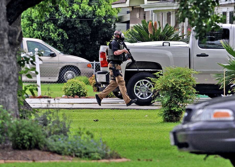 Groves police, assisted by Port Arthur, jefferson County, and Texas Department of Public Safety troopers set a perimeter around a home in Groves on Jackson Street where a man barricaded himself inside the home and refused to leave. Photo taken: Randy Edwards/The Enterprise
