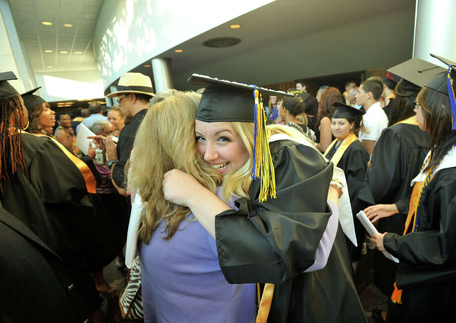 Avery Welch hugs her mother, Lisa Dishongh, after the Academy of Information Technology and Engineering commencement ceremony at Rippowam Middle School in Stamford on Wednesday, June 19, 2013. Photo: Jason Rearick / Stamford Advocate