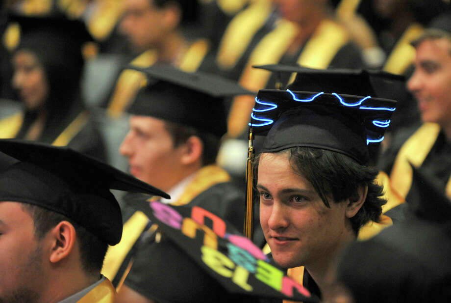 Stephen DeLay sports a cap with lights during the Academy of Information Technology and Engineering commencement ceremony at Rippowam Middle School in Stamford on Wednesday, June 19, 2013. Photo: Jason Rearick / Stamford Advocate