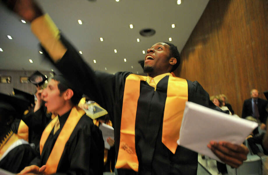 Peter Burke throws his cap in the air during the conclusion of the Academy of Information Technology and Engineering commencement ceremony at Rippowam Middle School in Stamford on Wednesday, June 19, 2013. Photo: Jason Rearick / Stamford Advocate
