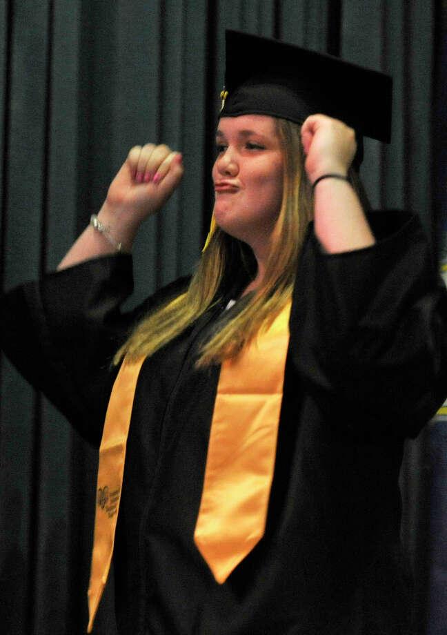 Taylor Droney celebrates as she is called to the stage to receive her diploma during the Academy of Information Technology and Engineering commencement ceremony at Rippowam Middle School in Stamford on Wednesday, June 19, 2013. Photo: Jason Rearick / Stamford Advocate