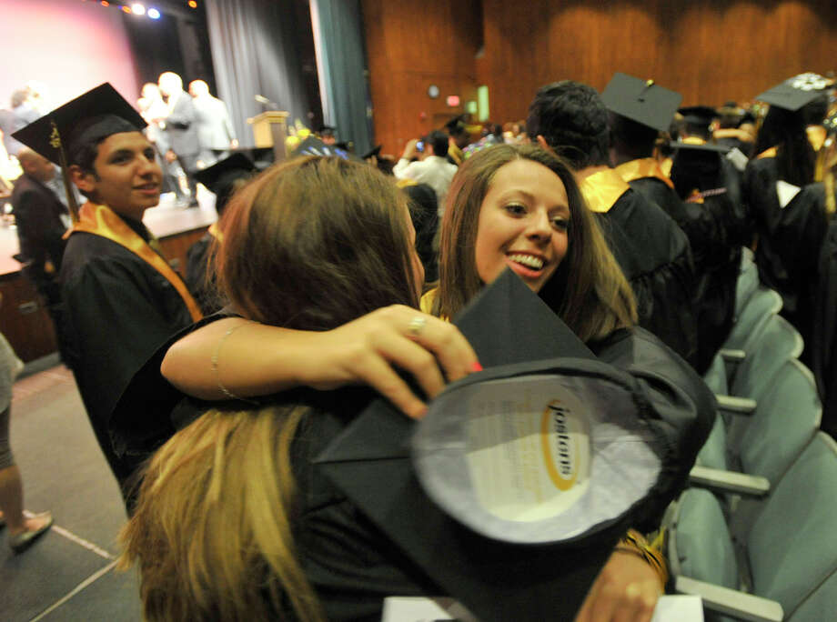 Anna Drenckhahn, right, hugs fellow graduate Taylor Droney after the Academy of Information Technology and Engineering commencement ceremony at Rippowam Middle School in Stamford on Wednesday, June 19, 2013. Photo: Jason Rearick / Stamford Advocate