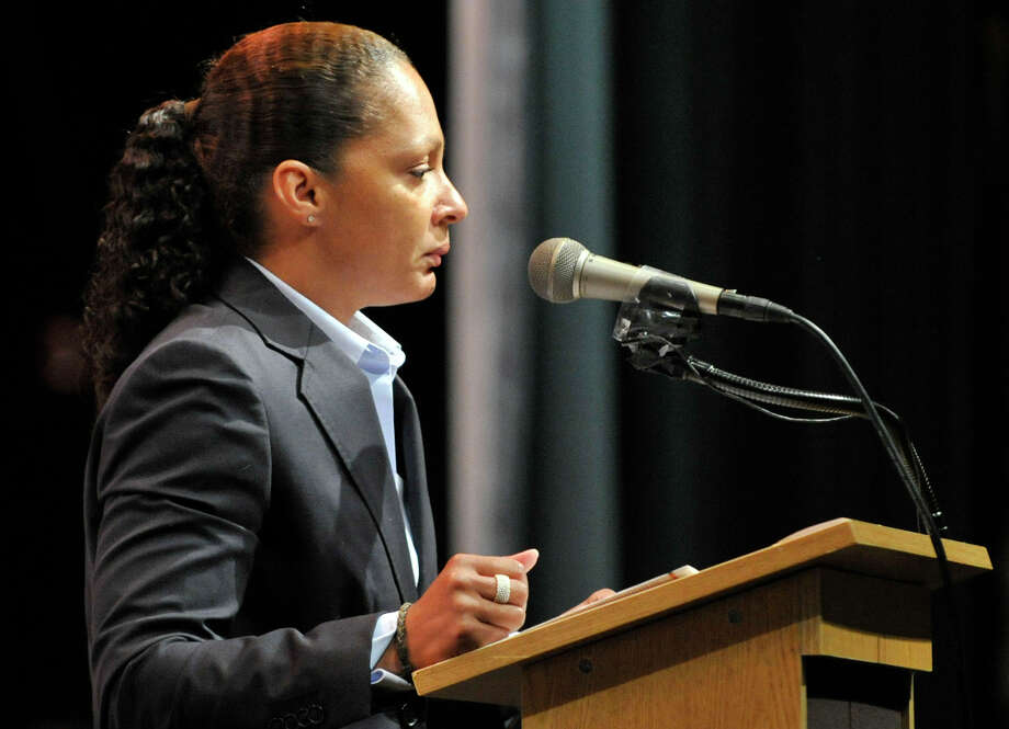 Vikki Cooper, deputy cormoration counsel for the city of Stamford, speaks during the Academy of Information Technology and Engineering commencement ceremony at Rippowam Middle School in Stamford on Wednesday, June 19, 2013. Photo: Jason Rearick / Stamford Advocate