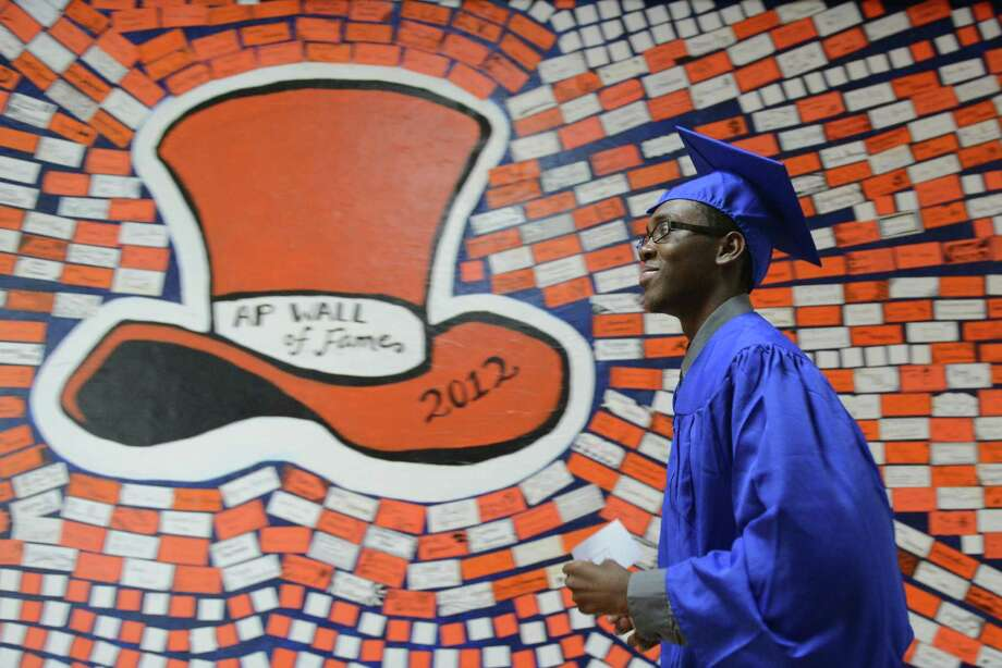 Quincy Jones Chapman walks through the halls before the Danbury High School commencement ceremony in Danbury, Conn. on Wednesday, June 19, 2013.  639 Danbury seniors crossed the stage at this year's graduation. Photo: Tyler Sizemore / The News-Times