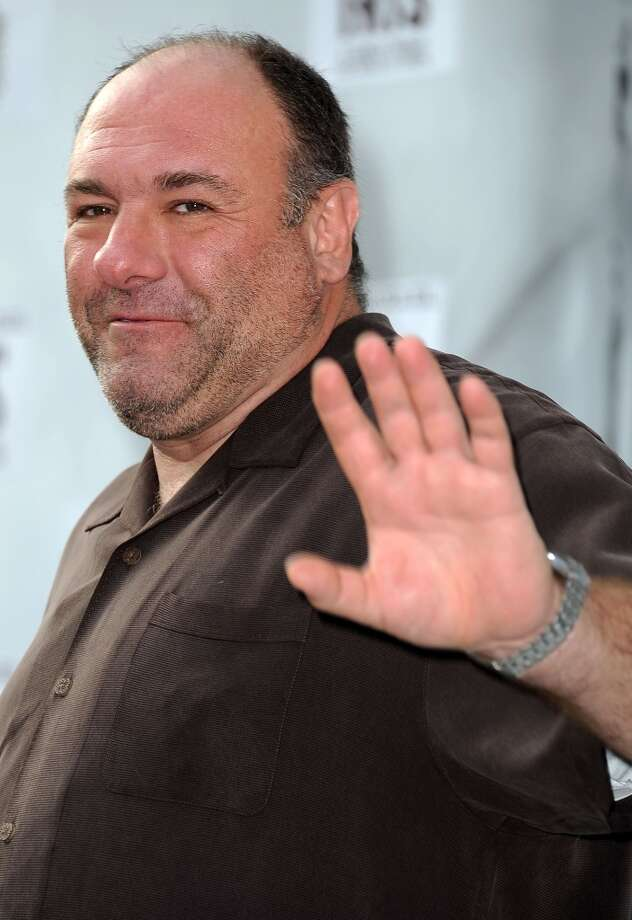 """This September 25, 2011 file photo shows US actor James Gandolfini attending IRIS, A Journey Through the World of Cinema by Cirque du Soleil, in Hollywood, California.  According to US media reports, Gandofini, who starred as mob boss Tony Soprano in """"The Sopranos"""", died while on vacation in Italy on June 19, 2013.  He was 51.   AFP PHOTO / Files / Valerie MACONVALERIE MACON/AFP/Getty Images"""