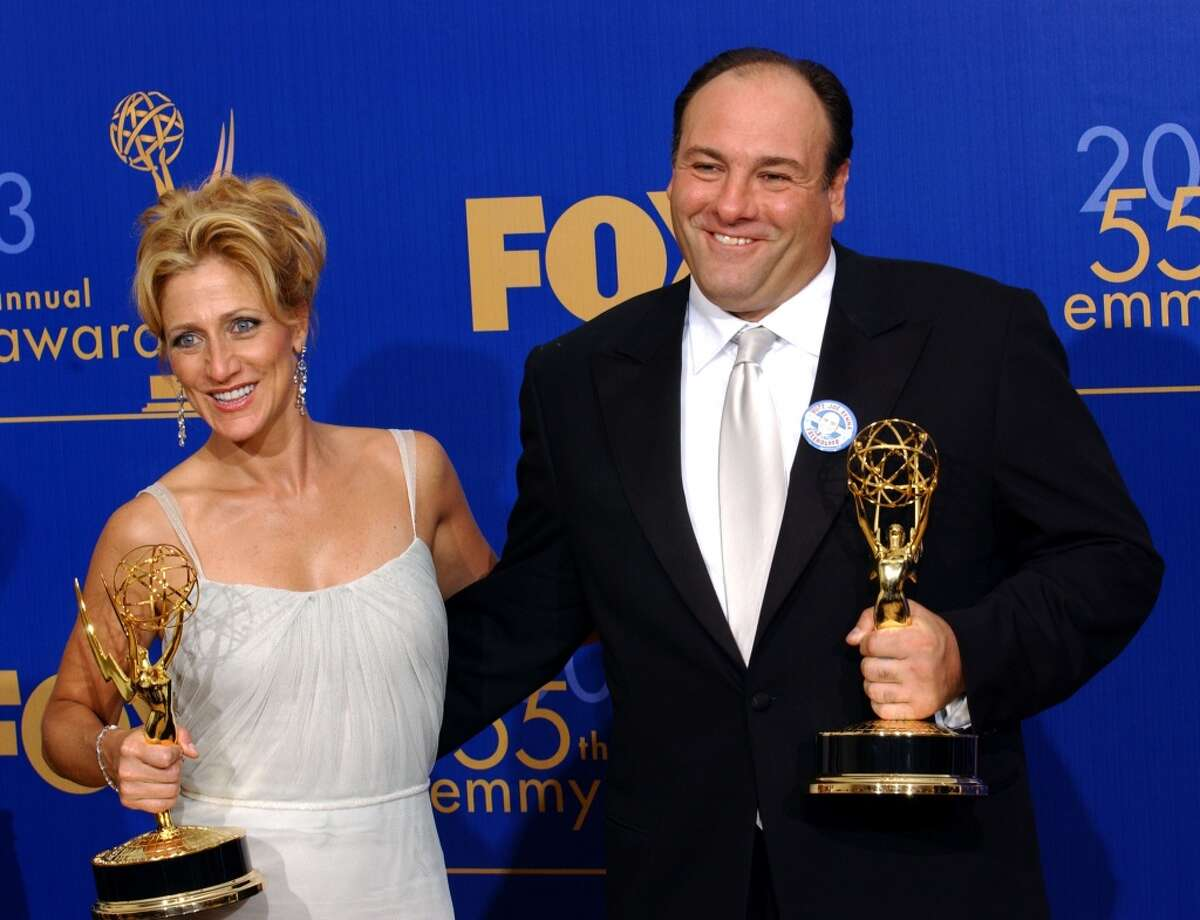 """Edie Falco and James Gandolfini winners of the awards for Outstanding lead Actress and Actor in a Drama Series for """"The Sopranos"""" at the 55th Annual Primetime Emmy Awards (Photo by Bob Riha Jr/WireImage)"""