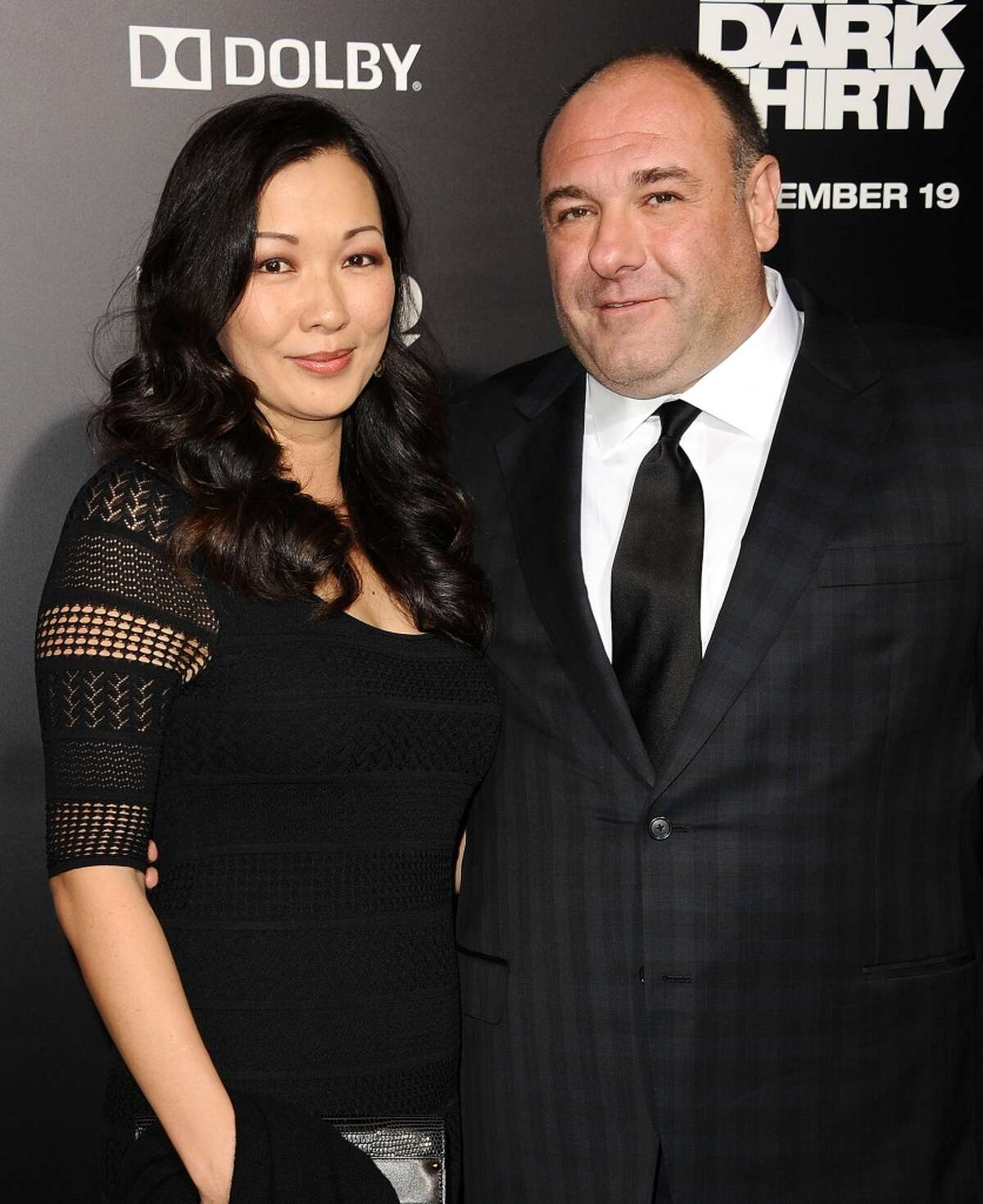 """Actor James Gandolfini (R) and wife Deborah Lin attend the premiere of """"Zero Dark Thirty"""" at the Dolby Theatre on December 10, 2012 in Hollywood, California. (Photo by Jason LaVeris/FilmMagic)"""