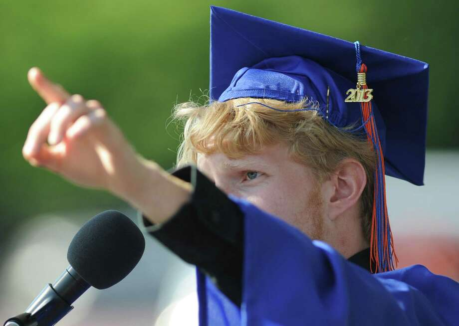 "Nicholas Carlsen speaks of the ""Danbury Renaissance"" during the Danbury High School commencement ceremony in Danbury, Conn. on Wednesday, June 19, 2013.  639 Danbury seniors crossed the stage at this year's graduation. Photo: Tyler Sizemore / The News-Times"